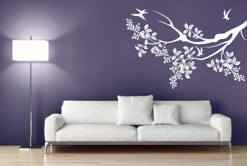 Naklejka ścienna biała gałązka z ptaszkami do dekoracji salonu.